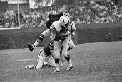 Baltimore Colts flanker Willie Richardson (87) just barely got the ball as Chicago Bears defensive back Bernie McRae leaps on top of Richardson on Oct. 8, 1967 in Chicago. Play started when John Unitas passed to Richardson for a short gain in third quarter of game in Chicago. TheColts won 24-3.