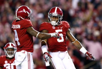Cyrus Jones, right, of the Alabama Crimson Tide reacts after intercepting a pass at Bryant-Denny Stadium on November 15, 2014 in Tuscaloosa, Alabama.