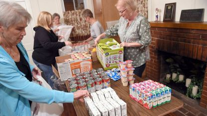Members of the Woman's Club of Laurel pack food for the club's Tummy Tamers program last year at the clubhouse on Main Street.
