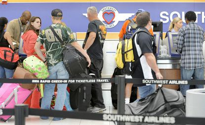Travelers check in at BWI's Southwest ticket counter.
