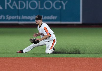 Aberdeen infielder Adam Hall makes the sliding grab on a bouncing Brooklyn grounder during the game Tuesday at Leidos Field at Ripken Stadium.