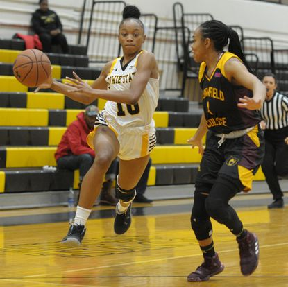 Bowie State's Kyaja Williams dribbles against Bloomfield College on Jan. 2, 2020.