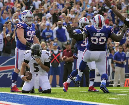 Ravens quarterback Joe Flacco is sacked in the second quarter against the Buffalo Bills in Orchard Park, N.Y. on Sept. 29.