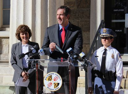 Maryland Del. Shelly Hettleman, left, Baltimore County Executive Johnny Olszewksi, Jr. and Baltimore County Police Chief Melissa Hyatt announce the county's $300,000 grant award from the Hackerman Foundation in Towson Monday morning.