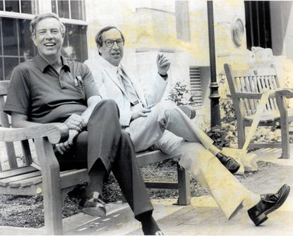 Stanley Getz, left, and his brother, Alan Getz, sit on a bench in Bel Air. The bench was dedicated to their mother, Tillye Getz.