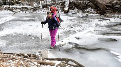 Shannon McDonald of Towson carefully crosses the frozen stream below Kilgore Falls in Pylesville Wednesday afternoon as she and her son Gus hike to see the frozen beauty of the popular landmark.