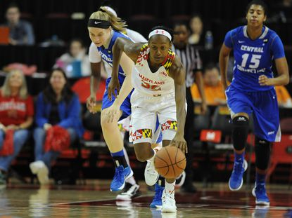 Maryland's Shatori Walker-Kimbrough runs the ball on a fast break ahead of Central Connecticut State's Nicole Ferguson, left, and Geocelis Reynoso in the first half, Saturday, Dec. 5, 2015, in College Park. Maryland won, 86-43.