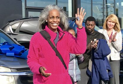 Fadina Middleton, of Joppa, smiles as she holds the keys to her new car, which she received through Vehicles for Change during a ceremony Friday at Heritage Mazda Bel Air. Middleton was one of five people who received a vehicle that Heritage MileOne Autogroup donated to Vehicles for Change, which provides transportation to families in need.