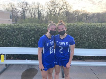 Camryn Pfundstein (18) and Gracie Driggs (2) were the catalysts for St. Mary's 13-5 victory over Roland Park on Wednesday.