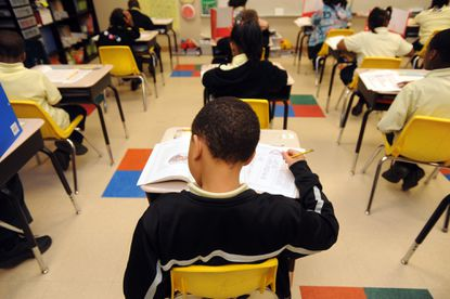 Identifying and assisting struggling students is considered a key element in education reform. Merely improving the quality of instruction won't necessarily help students facing problems of poverty or behavioral issues at home. (Barbara Haddock Taylor/Baltimore Sun).