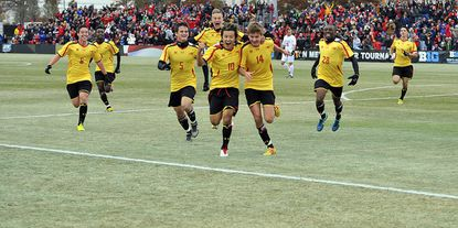 Maryland men's soccer players celebrate after winning the Big Ten Conference tournament championship with a 2-1 victory against Indiana on Sunday at Ludwig Field.
