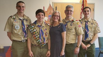 Tim Paulis, second from left, is the newest family member to become an Eagle Scout. Others pictured are, from left, Ben Paulis, Nancy Neu Paulis, Brad Paulis and Scott Paulis.