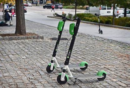 Bird scooters waiting to be rented park along Pratt and Light streets at the Inner Harbor in Baltimore. Scooter sharing companies have recently expressed interest in operating in Howard County and the County Council is considering legislation to allow scooters in the area.
