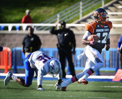 Morgan State quarterback Moses Skillon, right, runs away from Savannah State's Trevion Ashford for 48 yards in the second quarter at Hughes Stadium on Oct. 10, 2015.