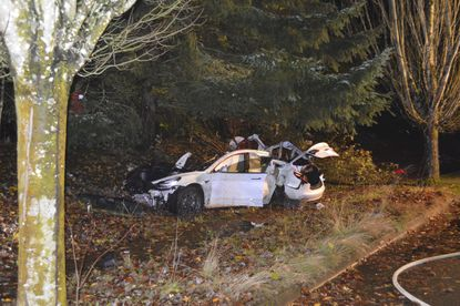 In this Nov. 17, 2020, file photo provided by the Corvallis Police Department is the scene where an Oregon man crashed a Tesla while going about 100 mph, destroying the vehicle, a power pole and starting a fire when some of the hundreds of batteries from the vehicle broke windows and landed in residences in Corvallis, Ore. Dylan Milota, who survived the crash, was driving the 2019 Tesla S when he lost control. Pandemic lockdowns and stay-at-home orders kept many drivers off U.S. roads and highways in 2020. But those who did venture out found open lanes that only invited reckless driving, leading to a sharp increase in traffic-crash deaths across the country. (Corvallis Police Department via AP, File)