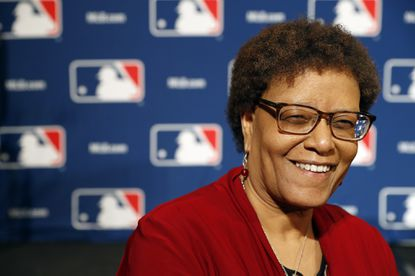 Claire Smith, ESPN's news editor of remote productions, poses during Major League Baseball's winter meetings, Tuesday, Dec. 6, 2016 in Oxon Hill, Md. Smith is the first woman to win the J.G. Taylor Spink Award for meritorious contributions to baseball writing and will be honored during the Hall of Fame's induction weekend next July in Cooperstown, New York.