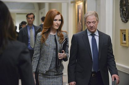 Abby (Darby Stanchfield) and Cyrus (Jeff Perry) do a walk-and-talk.