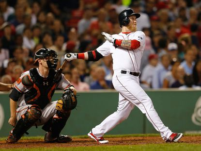 BOSTON, MA - AUGUST 28: Mike Carp #37 of the Boston Red Sox singles in the in the go-ahead run in the 8th inning against the Baltimore Orioles at Fenway Park on August 28, 2013 in Boston, Massachusetts. The Red Sox won 4-3. (Photo by Jim Rogash/Getty Images) ORG XMIT: 163495244