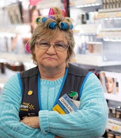 """Charlene Mull, an employee from the Walmart store in North East, Cecil County, Maryland, has become """"internet famous"""" for her quirky pictures and signature frown on the store's Facebook page. An online petition has begun to have her appear on """"Ellen."""""""
