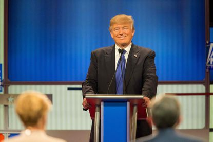 Republican presidential candidate Donald Trump smiles during Thursday night's GOP debate in Detroit, hosted by Fox News.