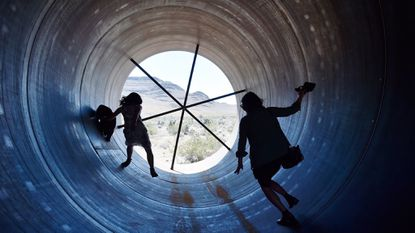 People walk through a Hyperloop tube after the first test of a propulsion system at the Hyperloop One Test in Las Vegas. Musk wants to build a Hyperloop between Baltimore and Washington.