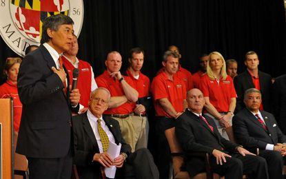 As University of Maryland President Wallace Loh speaks at a press conference announcing the school's forthcoming move to the Big 10 Conference, two rows of Terps coaches line up behind him in a show of support. Privately, there was some disagreement about the move.