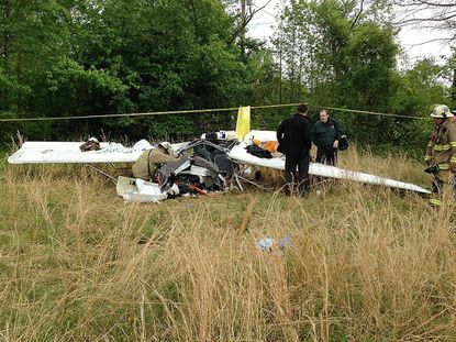Investigators look over the scene of a small plane crash that killed a Westminster man Saturday in Suffolk, Va.