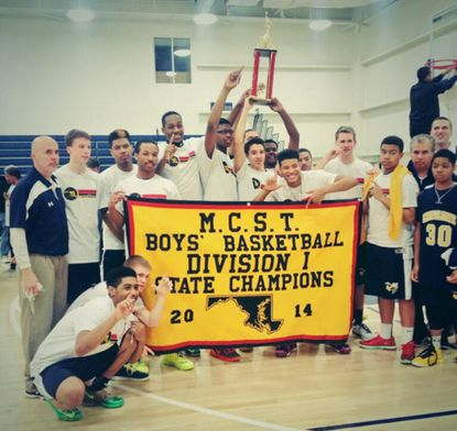 Chapelgate's boys basketball team celebrates after winning the Maryland Christian Schools Tournament over the weekend.
