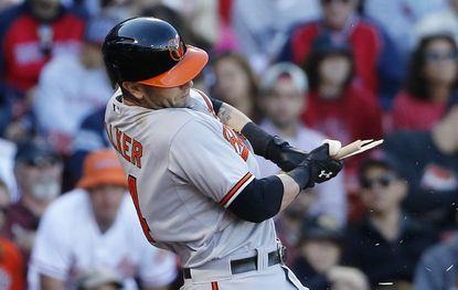 Baltimore Orioles' Christian Walker breaks his bat on a ground out during the ninth inning of a baseball game against the Boston Red Sox in Boston, Sunday, Sept. 27, 2015. The Red Sox won 2-0.