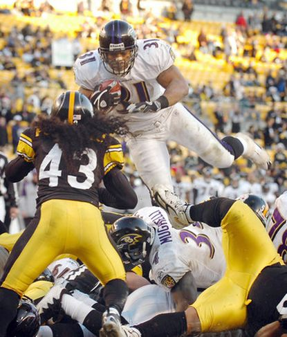 Ravens running back Jamal Lewis dives over the Steelers' defensive line and safety Troy Polamalu (43) for a fourth-quarter touchdown Dec. 24, 2006, at Heinz Field.