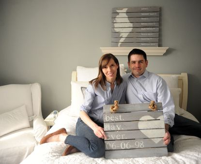 Kim Moayedi, left, and her husband, Chris, create whitewashed wood art under the brand name The Whitewashed Row Home in their Rodgers Forge home.