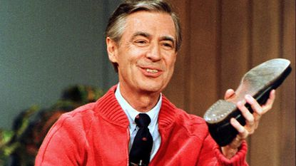 "This June 28, 1989, file photo, shows Fred Rogers as he rehearses the opening of his PBS show ""Mister Rogers' Neighborhood"" during a taping in Pittsburgh. Rogers and the show he starred in are chronicled in the documentary ""Won't You Be My Neighbor?"" airing on HBO and PBS Feb. 9"