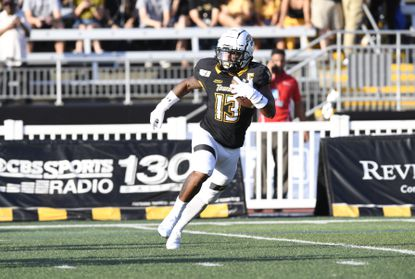 Towson running back Shane Simpson looks for an opening against North Carolina Central.
