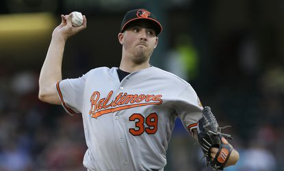 Orioles pitcher Kevin Gausman throws during the first inning of a game against the Rangers on June 20.