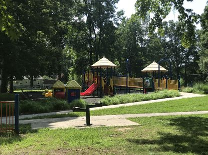 """Aberdeen Mayor Patrick McGrady encouraged residents to visit Victory Street Park, off APG Road, especially when it's hot outside, because it's shaded by large, old oak trees and has """"brand spanking new"""" equipment."""