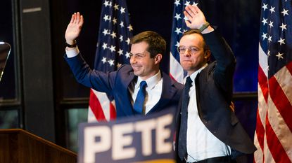 Former South Bend Mayor Pete Buttigieg and his husband Chasten Buttigieg respond to audience members after an announcement of Pete Buttigieg's ending the campaign for president, in South Bend, Ind., Sunday, March 1, 2020. Buttigieg, who rose from being the Indiana mayor to a barrier-breaking, top-tier candidate for the Democratic presidential nomination, ended his campaign on Sunday.