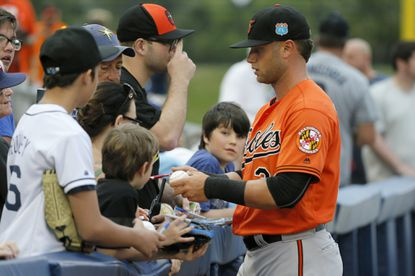 Orioles' Christian Walker signs autographs for fans before a spring training game against the Tampa Bay Rays on Saturday, March 19, 2016, in Port Charlotte, Fla.