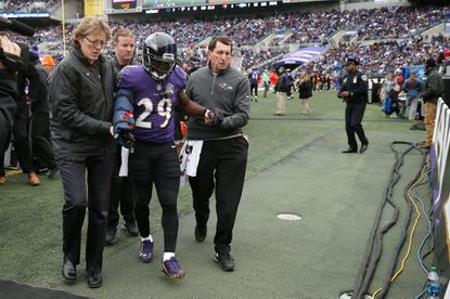 Running back Justin Forsett #29 of the Baltimore Ravens is helped off of the field after an injury in the first quarter against the St. Louis Rams at M&T Bank Stadium on November 22, 2015 in Baltimore, Maryland.