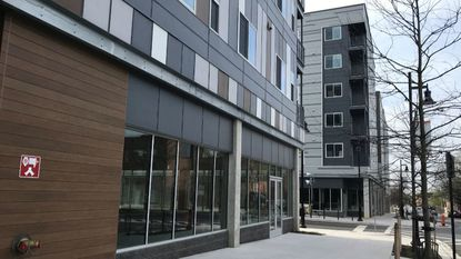 The Center\West apartment buildings in Poppleton have not opened yet, six months after a ribbon-cutting event, because of water damage.