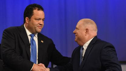 Democratic challenger Ben Jealous and Republican Governor Larry Hogan shake hands prior to their MPT debate last month.