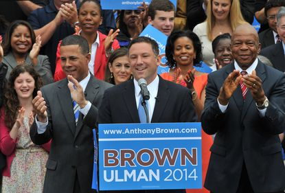 In Columbia, Howard County Executive Ken Ulman speaks to the crowd, after he was introduced by Lt. Gov. Anthony Brown (L) as his running mate for the 2014 Maryland governor's race. Rep. Elijah Cummings is on the right.