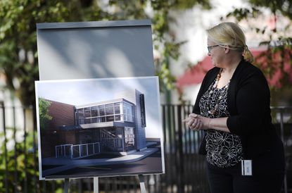 Carroll County Public Library executive director Andrea Berstler looks at a rendering of the Exploration Commons under construction during a rededication ceremony at the Westminster branch Friday, Sept. 18, 2020.