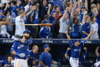 Toronto Blue Jays' Jose Bautista tosses his bat after hitting a three-run home run during the seventh inning in Game 5 of theAmerican League Division Series, Wednesday, Oct. 14, 2015 in Toronto..