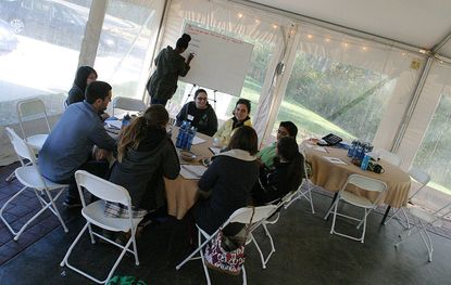Participants in the OWN It Summit discuss ideas to attract millennials to the outdoors at Irvine Nature Center Oct. 25.