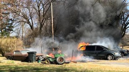 A fire in the 5600 block of Bartholow Road on Wednesday caught multiple vehicles and a dog kennel.