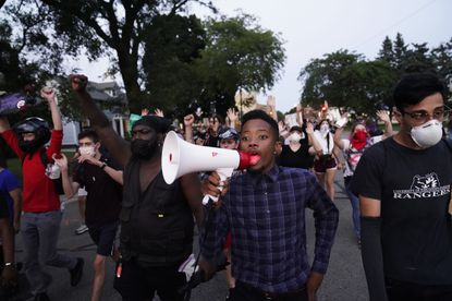Protesters march against the Sunday police shooting of Jacob Blake in Kenosha, Wisconsin, Wednesday.