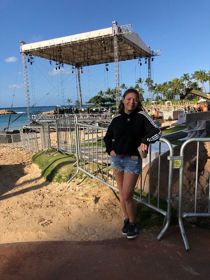 """Emma Kleinberg of Bel Air stands in front of the stage in Aulani Disney resort in Kapolei, Hawaii, where she competed as one of the top 40 contestants on """"American Idol."""""""