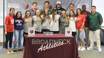 Student athletes at Broadneck pose for a group picture during a college athletics recognition event at Broadneck High School on Wednesday, Nov. 14.