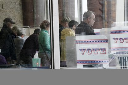 Early voters cast their ballots at the Zeidler Municipal Building in Milwaukee on March 18, 2020.