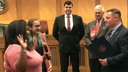 In this February photo, the newest members of the Havre de Grace Youth Commission are sworn in by Mayor William Maritn as Councilman Jason Robertson, center, and Council President David Glenn look on. On Monday, Robertson made a motion to increase the Youth Commission funding.